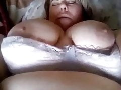 Heavy girl with a broad in the beam belly Masturbates.