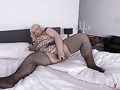 blonde mature BBW in sexy fishnet stockings and big natural breasts masturbating on web cam